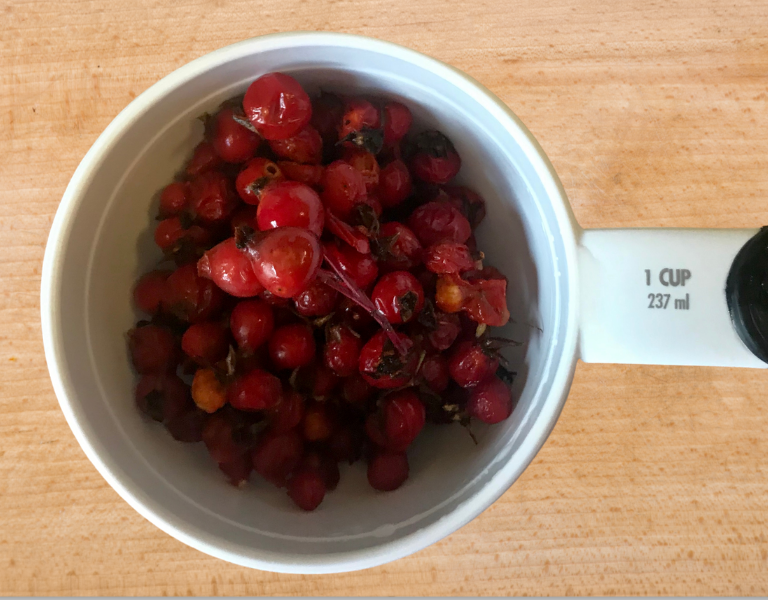 Rose hips in measuring cup